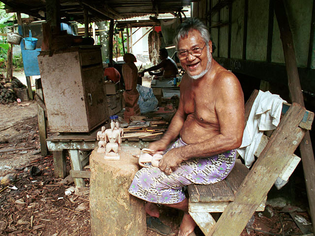 Wood carver Manasa Tom, with Nukuoro statues in Porakied, the Kapingamarangi village on Pohnpei, Federated States of Micronesia, © Sue Rosoff, All Rights Reserved : Pacific : Sue Rosoff Photography